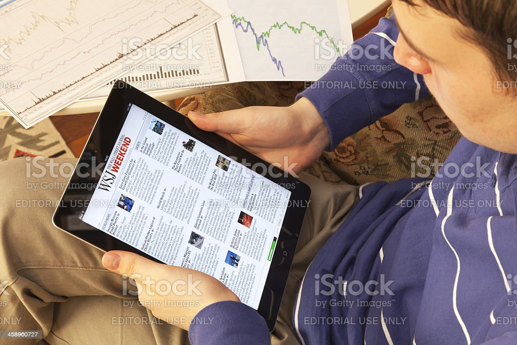 Young Businessman reading on ipad stock photo