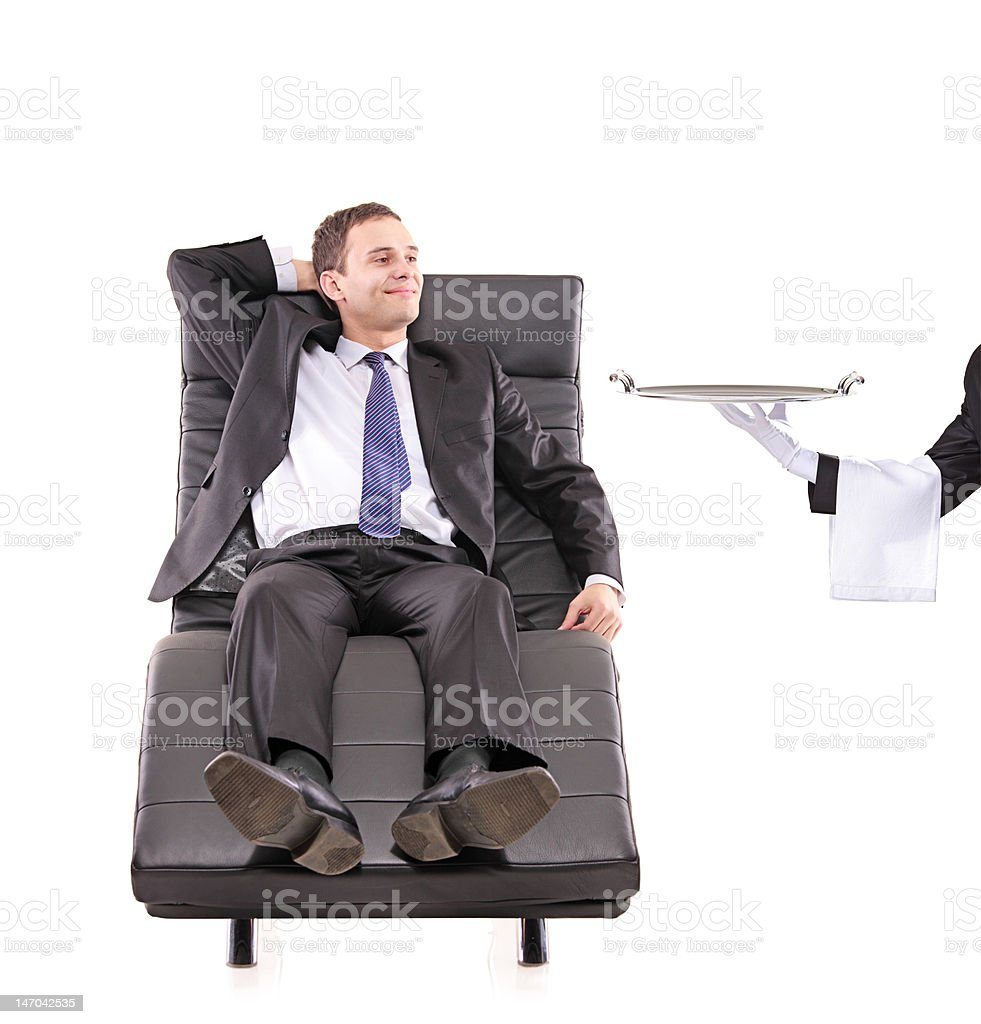 Young businessman relaxing on a sofa royalty-free stock photo
