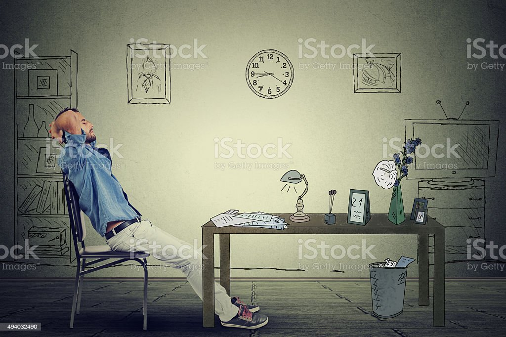 young businessman relaxing sitting in the office stock photo