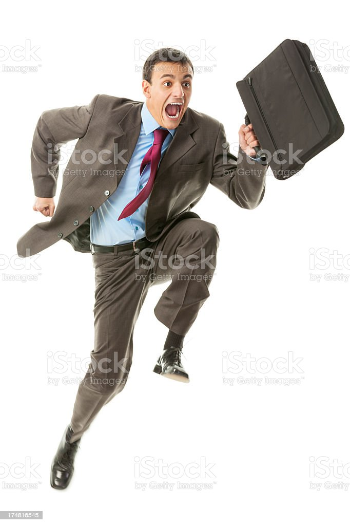 Young businessman running to get to work on time royalty-free stock photo