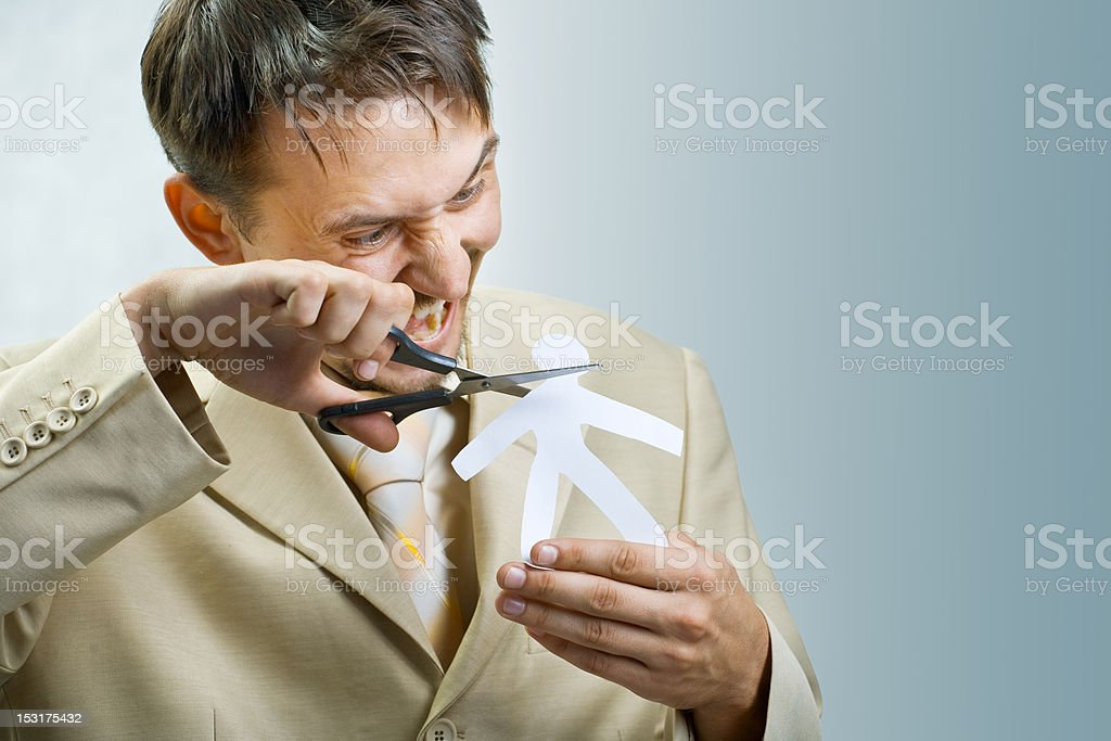 Young businessman scissor paper man royalty-free stock photo