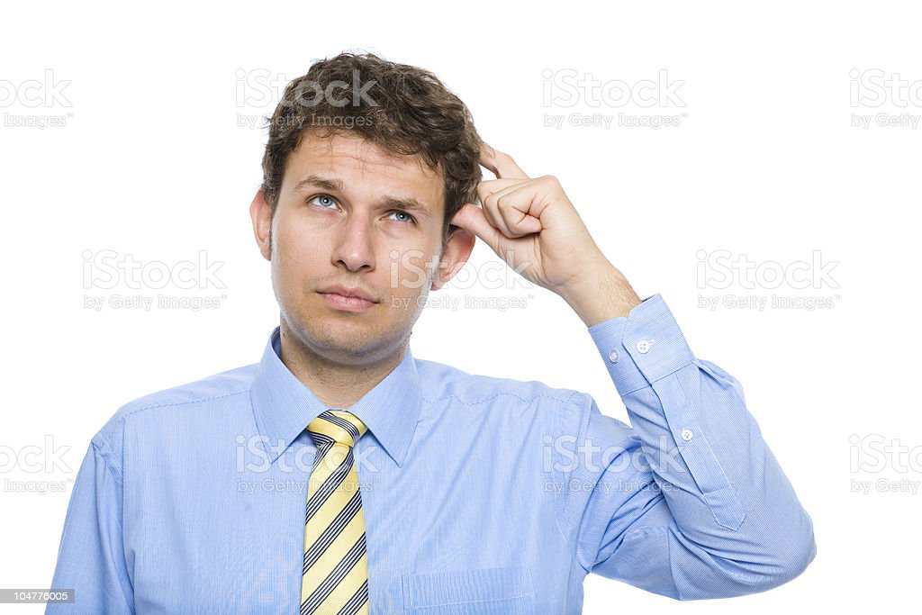 young businessman scratching his head, making decision royalty-free stock photo