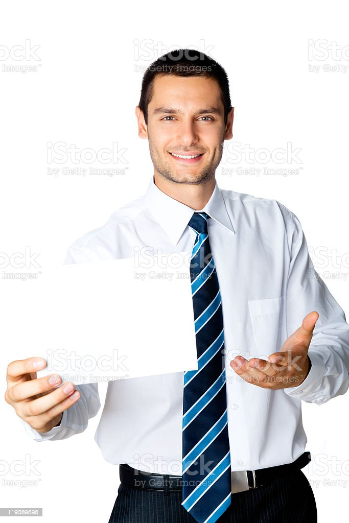 Young businessman showing signboard, isolated on white royalty-free stock photo