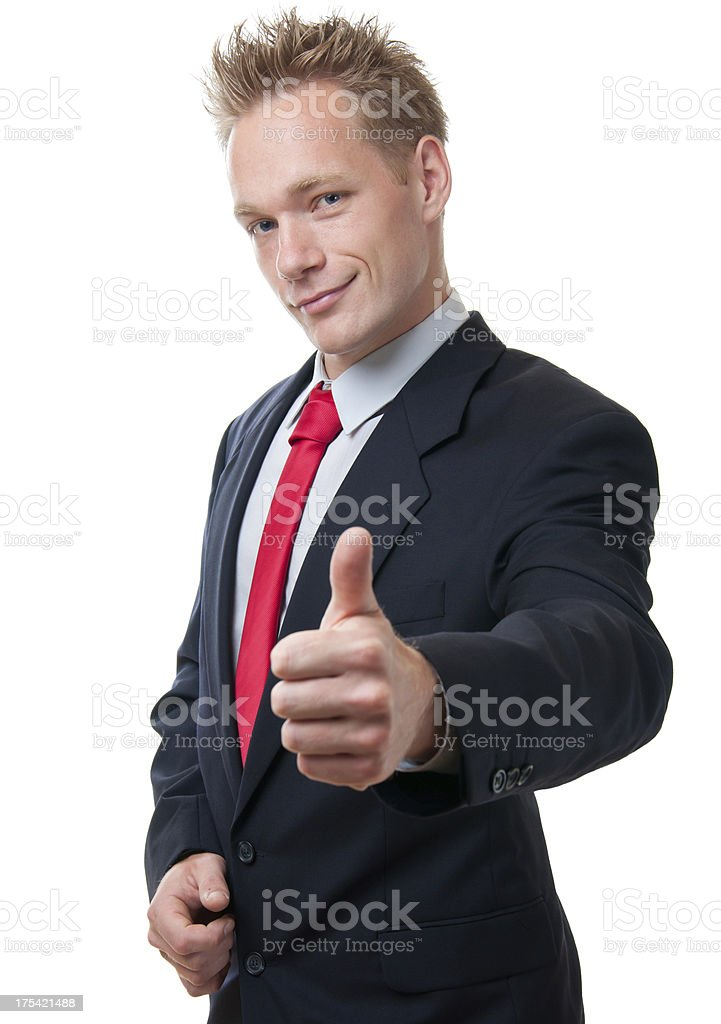 Young businessman showing thumbs up. stock photo