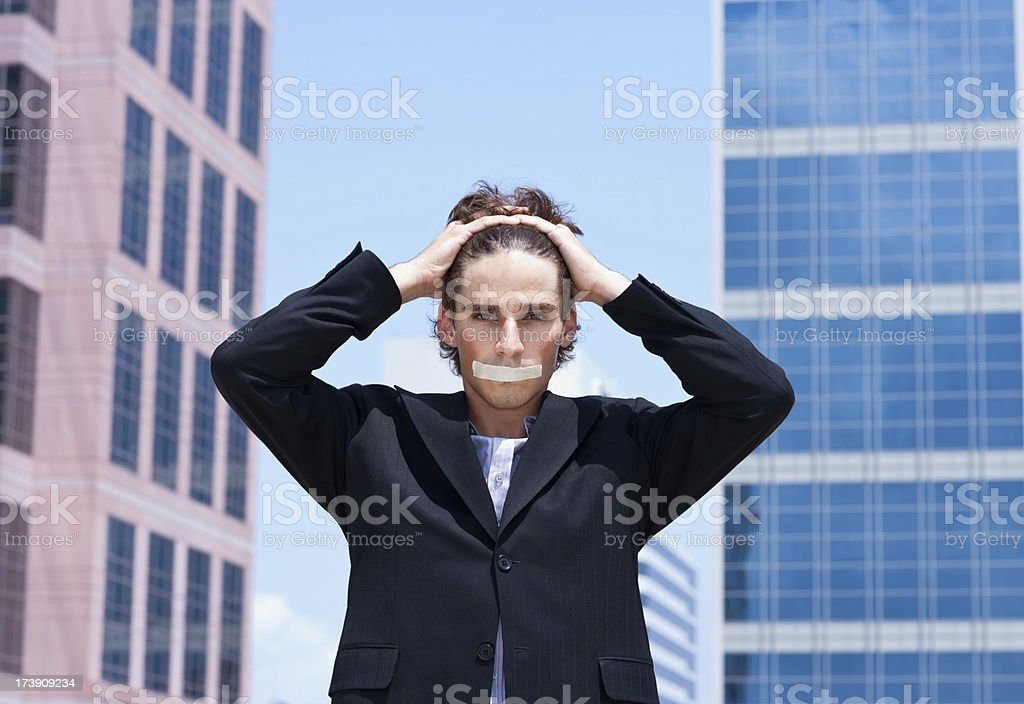 young businessman silenced by tape on his mouth royalty-free stock photo
