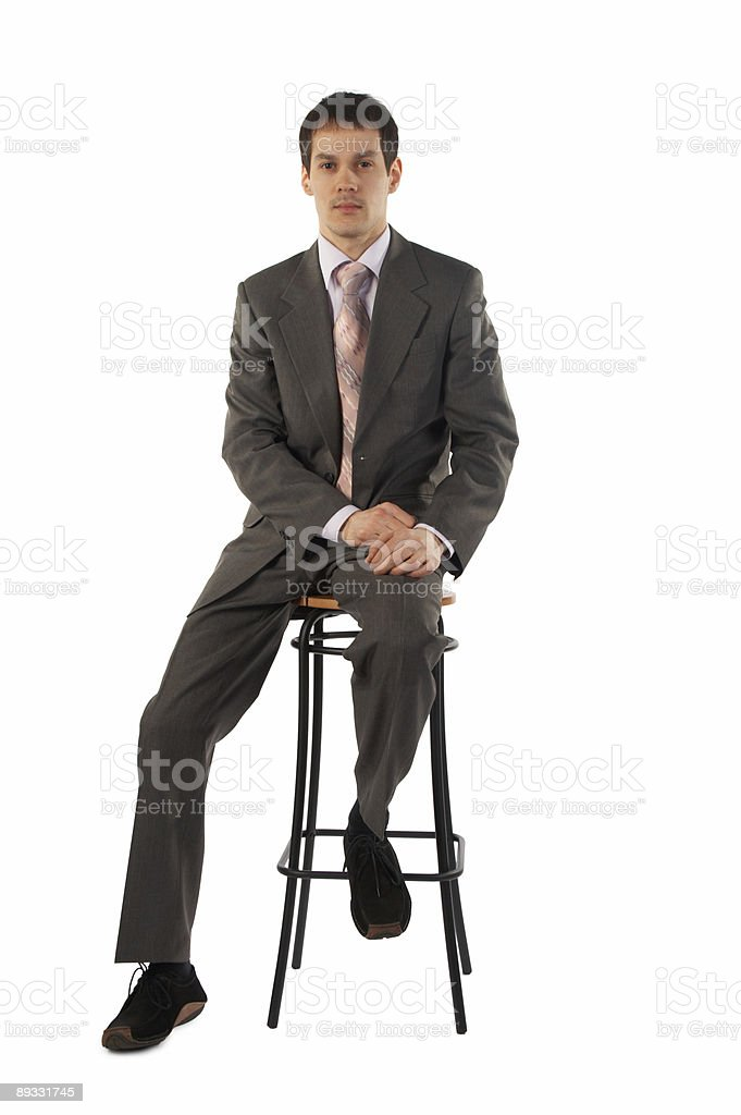 Young businessman sits on stool royalty-free stock photo
