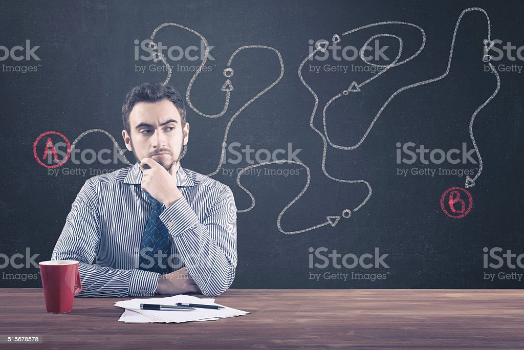 Young businessman sitting at desk stock photo