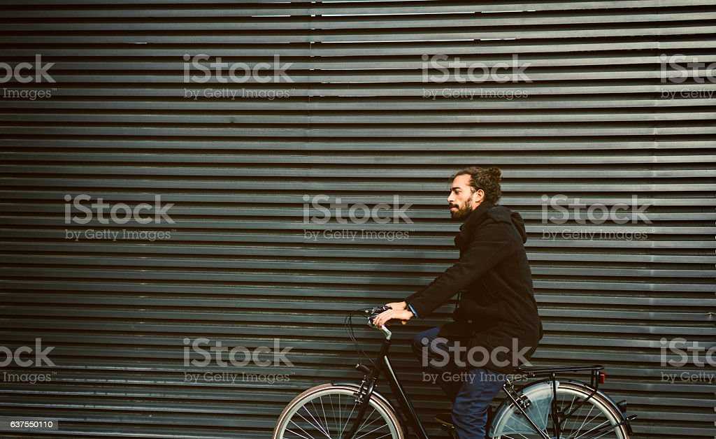Young Businessman Sitting On Bicycle Outdoors. stock photo