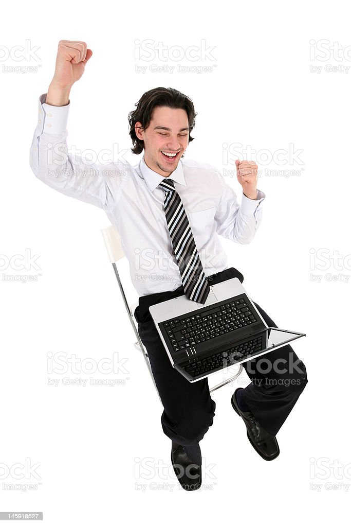 Young businessman sitting with laptop royalty-free stock photo