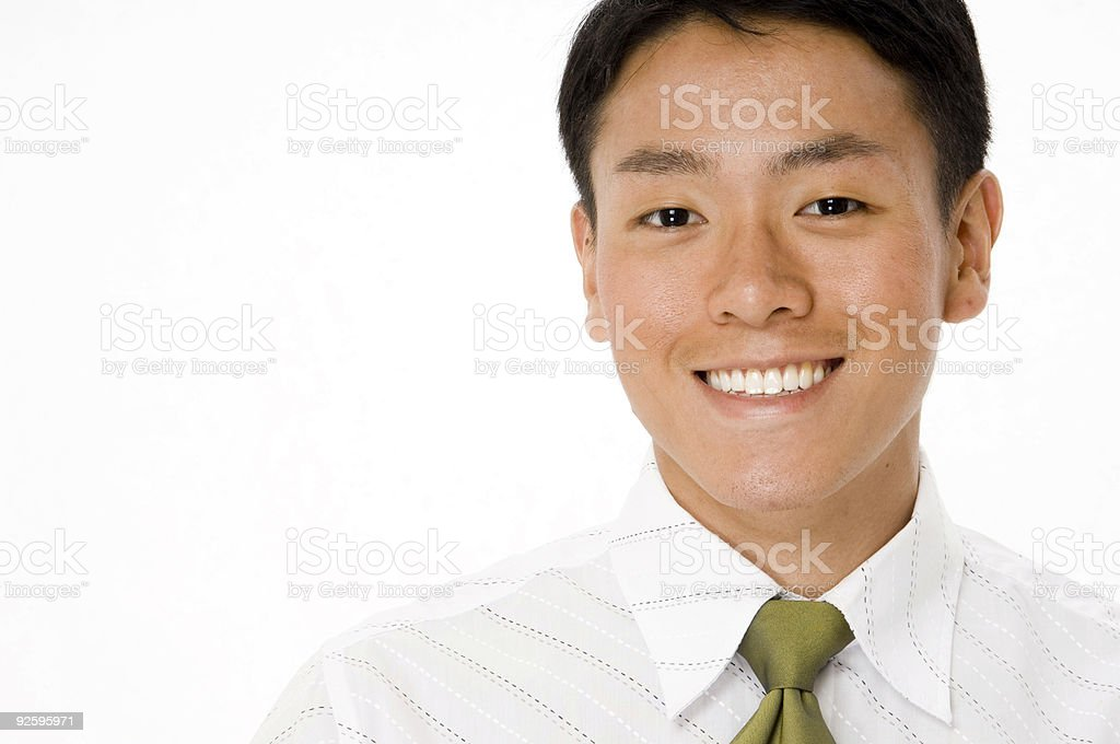 Young businessman smiling on a white background royalty-free stock photo