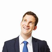 Young Businessman Smiling Upwards - Isolated