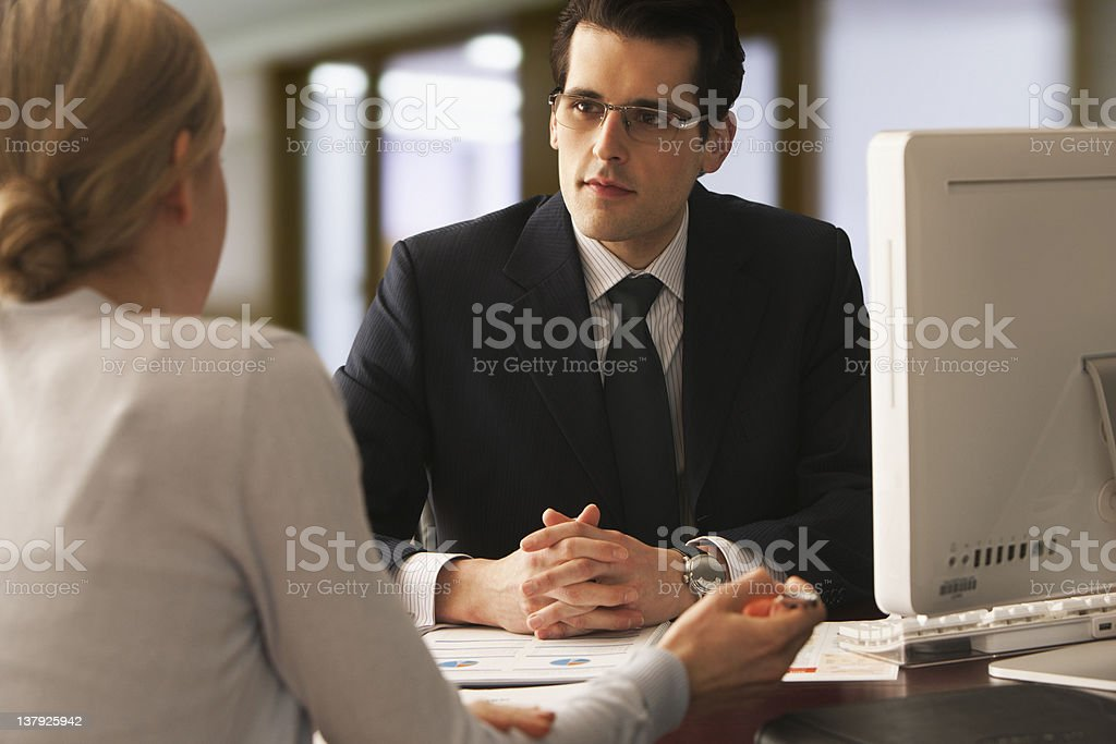Young businessman speaking to young woman royalty-free stock photo