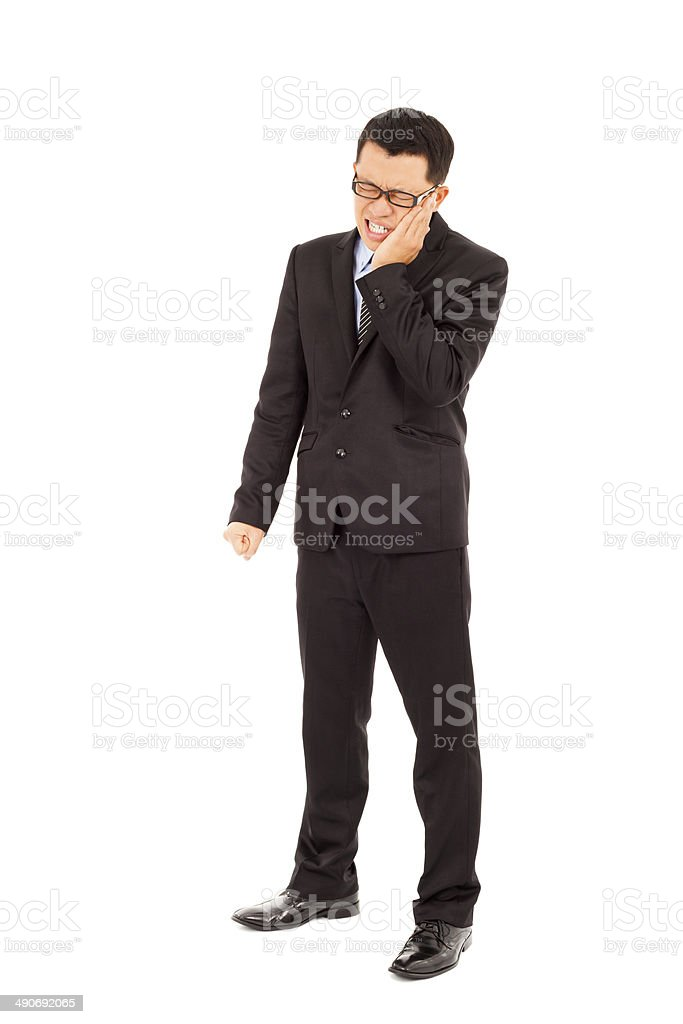 young businessman standing and in agony with a toothache royalty-free stock photo