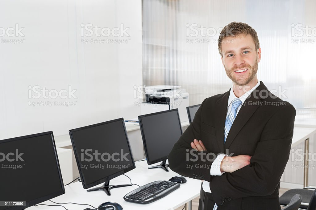 Young Businessman Standing Arms Crossed stock photo