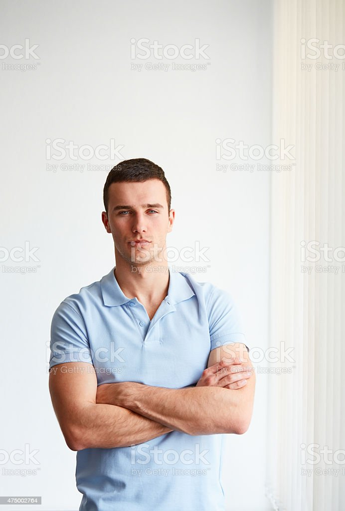 Young businessman standing in an office stock photo