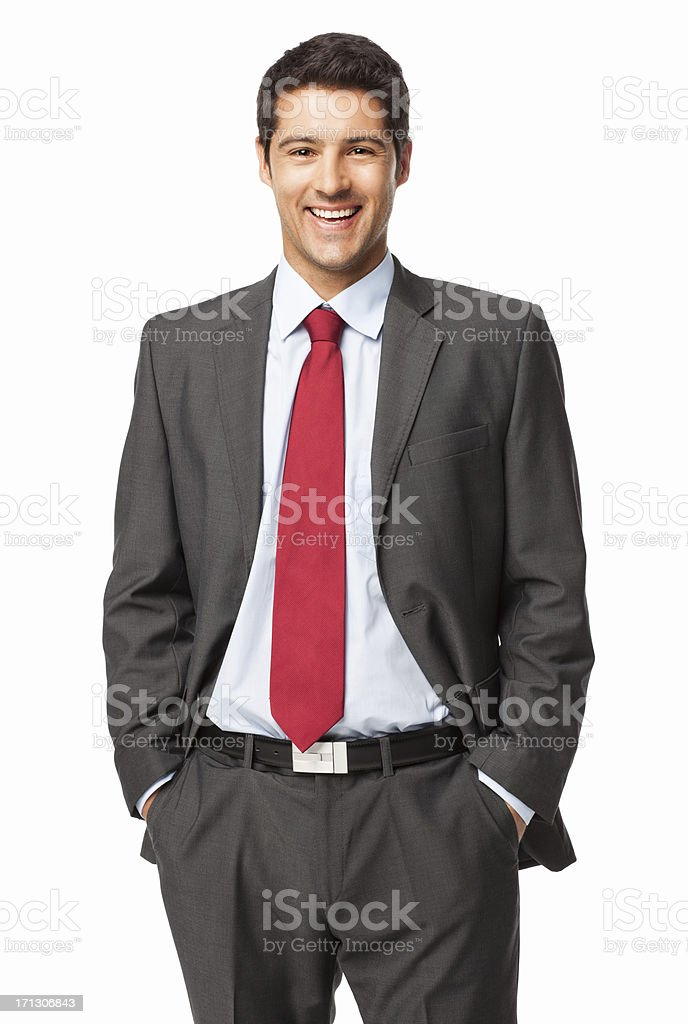 Young Businessman Standing With Hands In Pockets - Isolated stock photo