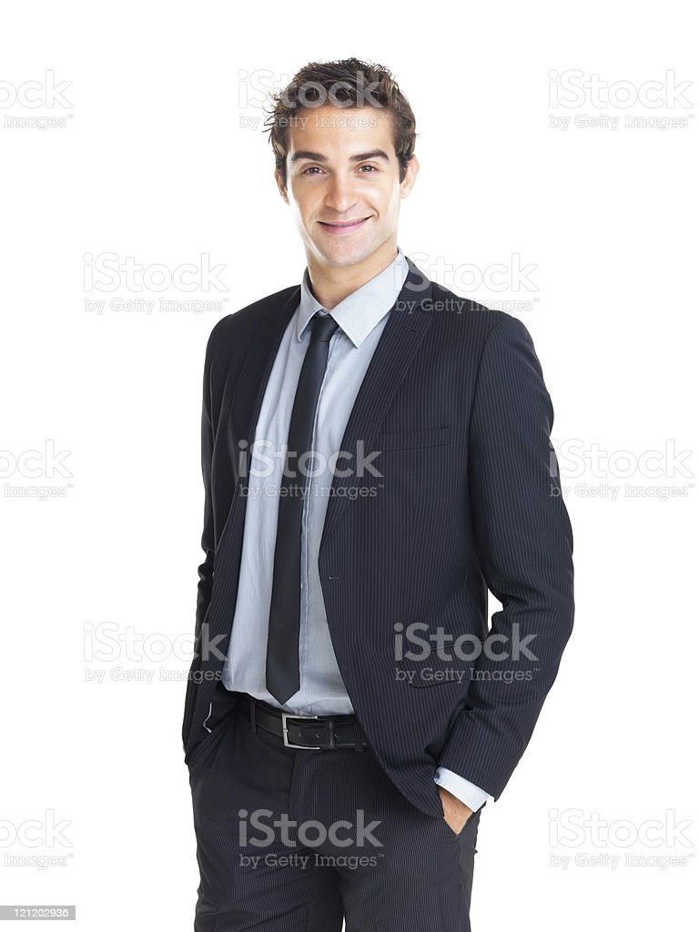 Young businessman standing with hands in pockets royalty-free stock photo