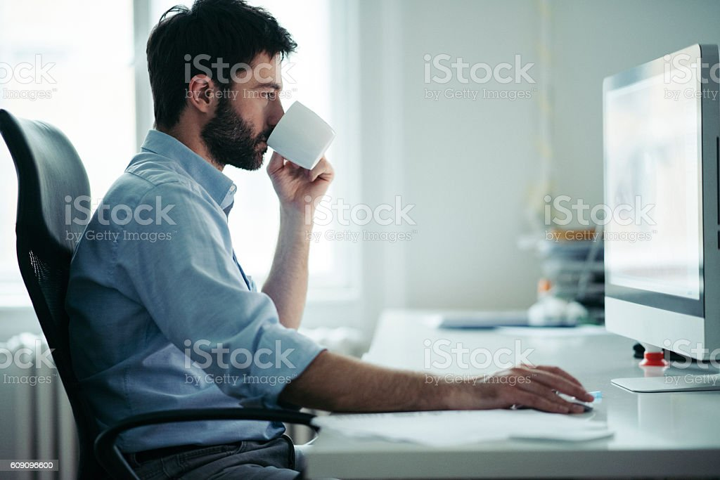 Young businessman starting his work day stock photo