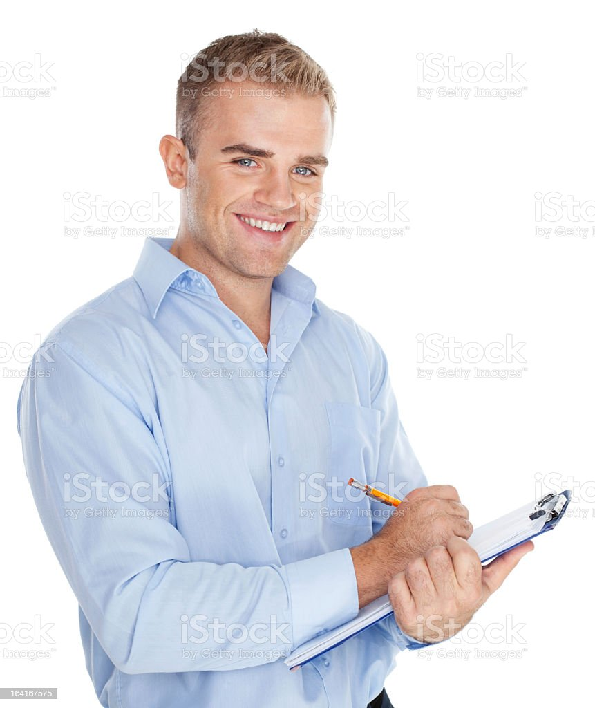Young businessman taking notes stock photo