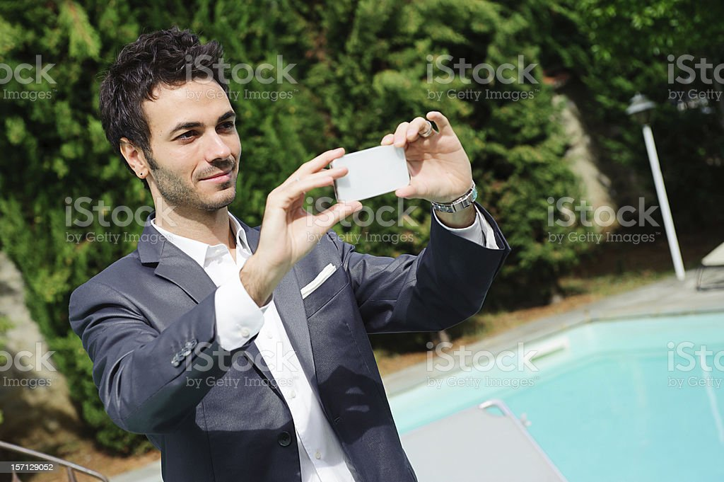 Young Businessman Taking Photos with Mobile royalty-free stock photo