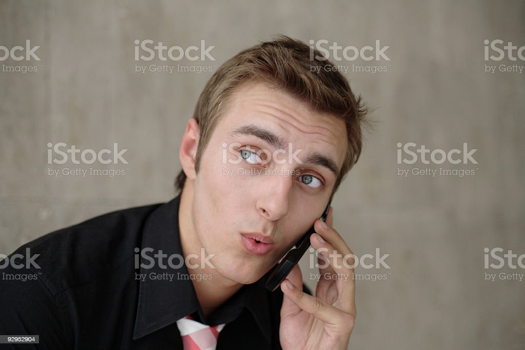 young businessman talking cellphone royalty-free stock photo