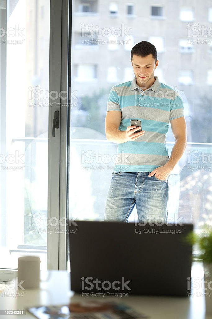 young businessman talking on phone royalty-free stock photo