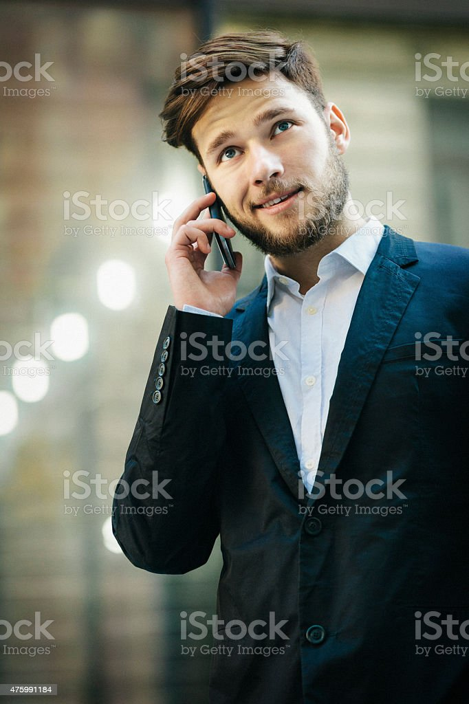 Young businessman talking on the cell phone stock photo