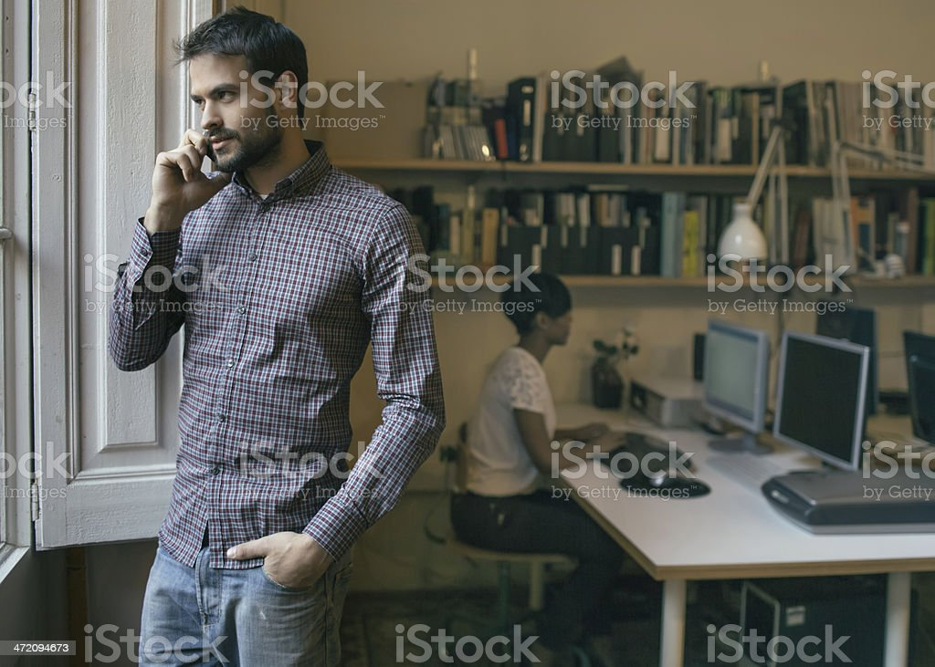 Young businessman talking on the mobile phone royalty-free stock photo