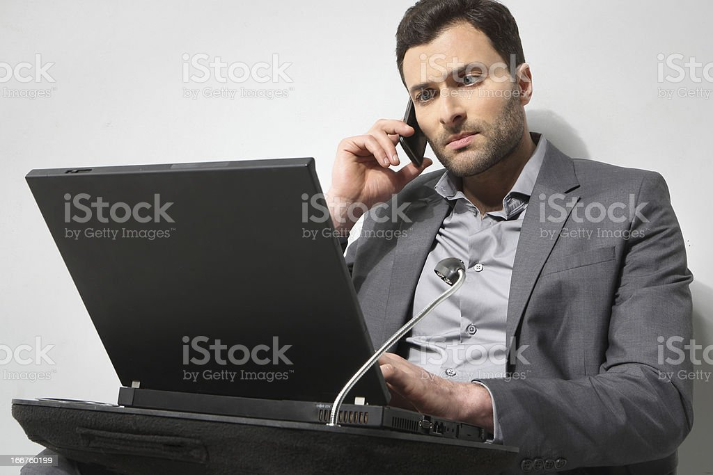 Young businessman talking on the phone and working royalty-free stock photo