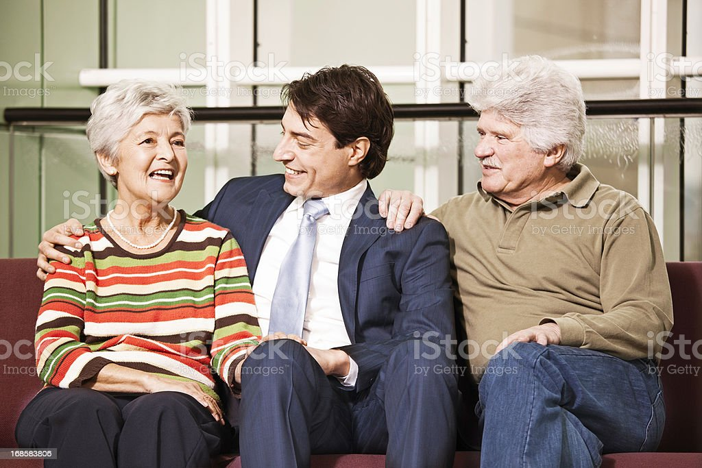Young businessman talking with his elderly parents royalty-free stock photo