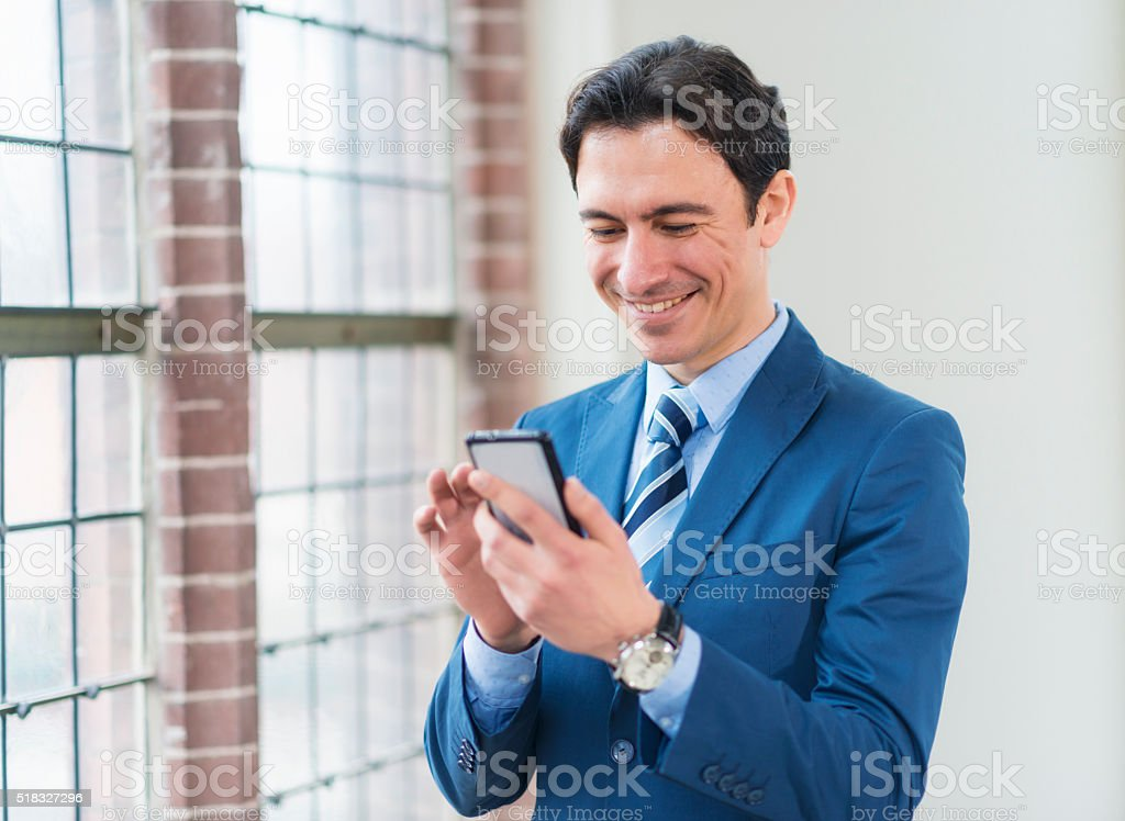 Young businessman texting stock photo