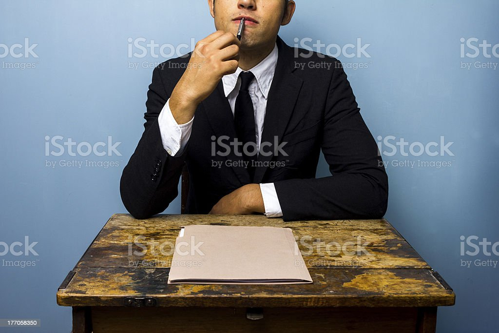 Young businessman thinking royalty-free stock photo