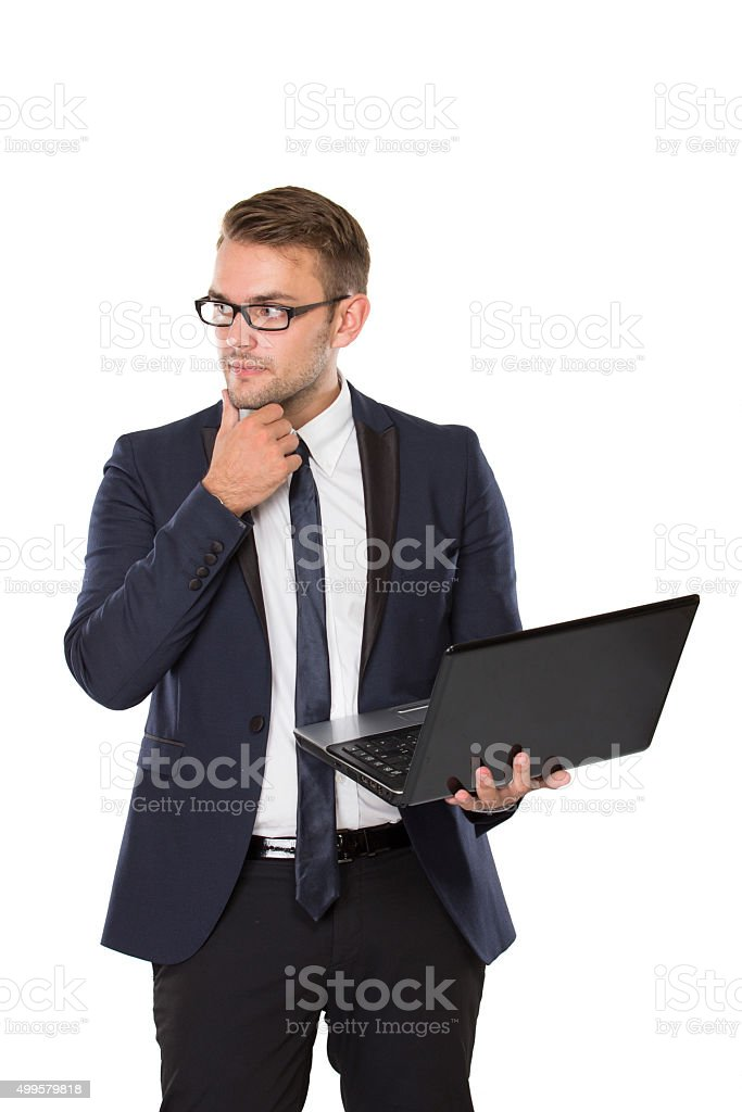 Young businessman thinking while bring laptop stock photo