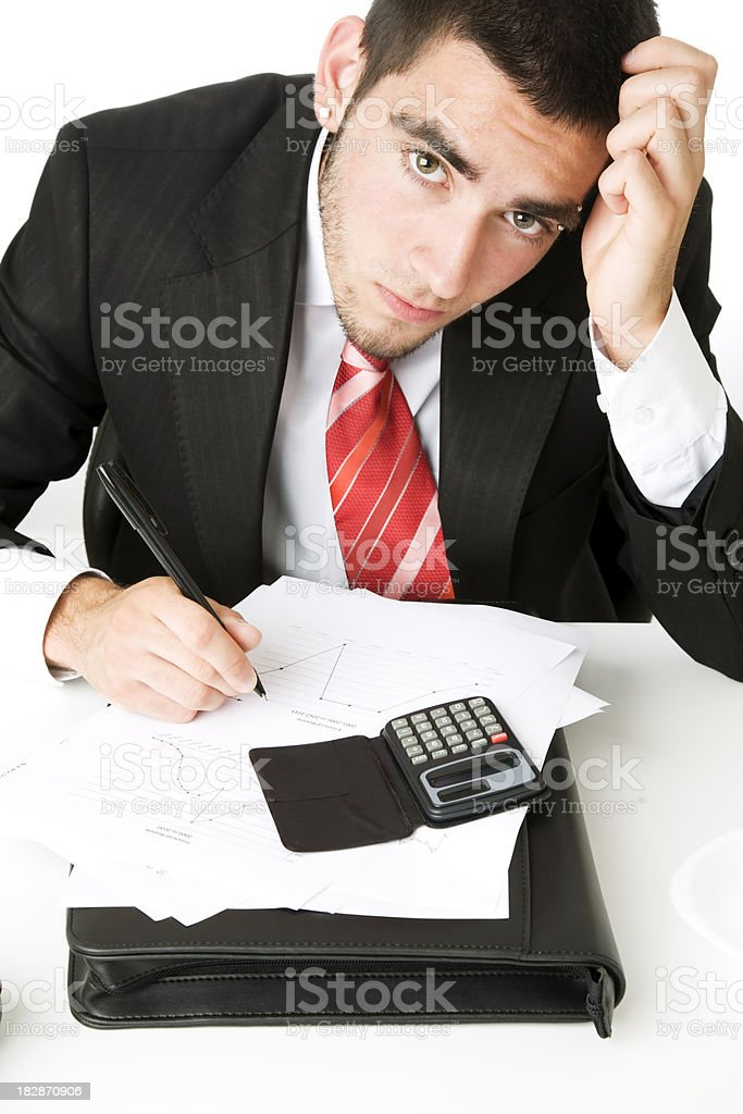 young businessman under pressure royalty-free stock photo