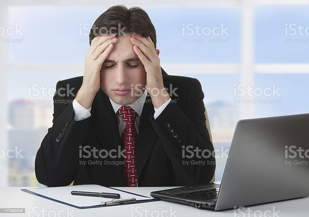 young businessman under stress, fatigue and headache royalty-free stock photo