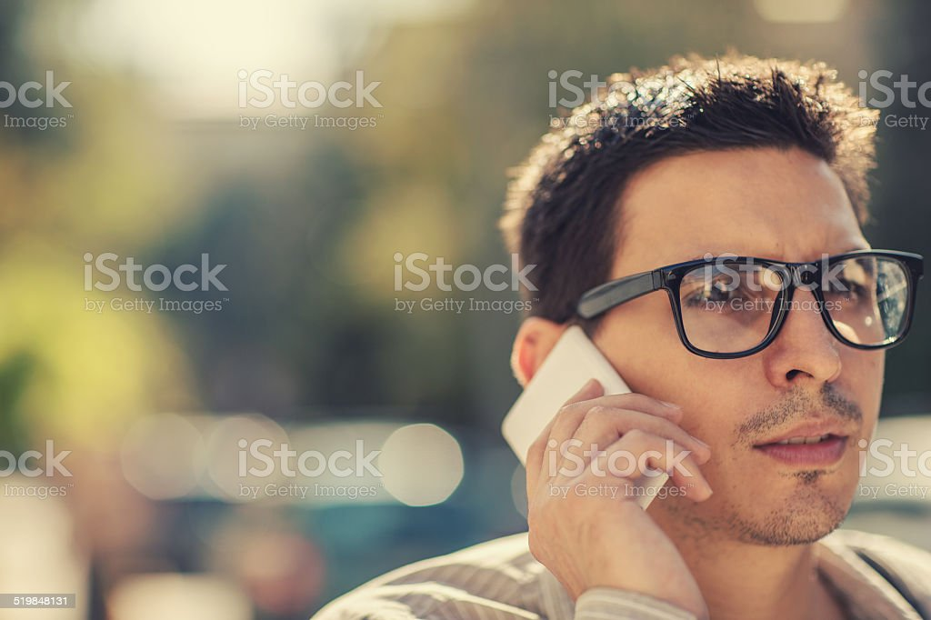 Young businessman using cell phone stock photo