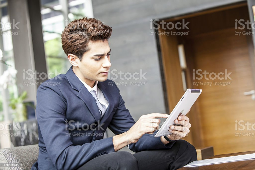 Young businessman using digital tablet pc. royalty-free stock photo