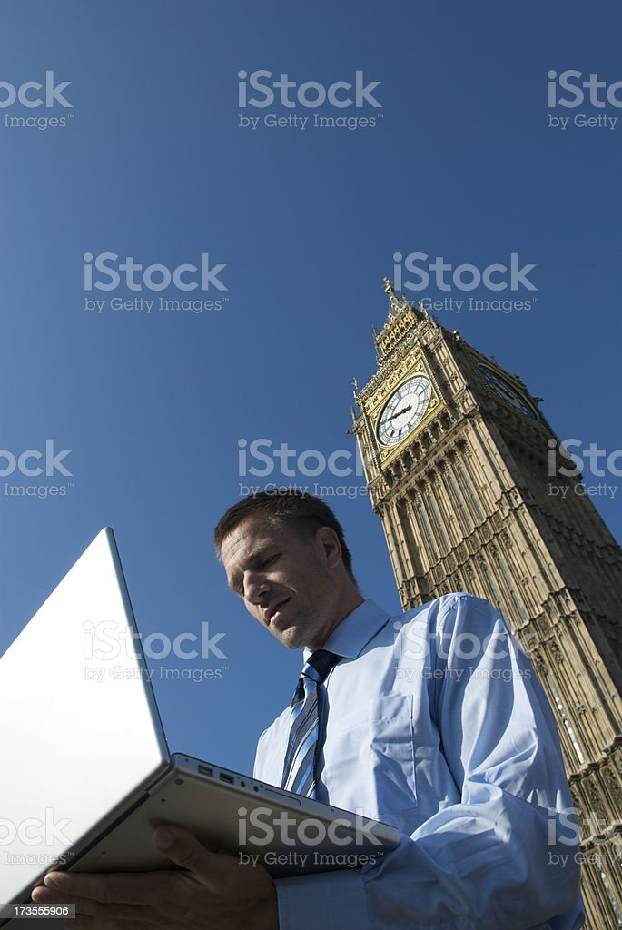 Young Businessman Using Laptop Outdoors Big Ben Westminster London royalty-free stock photo