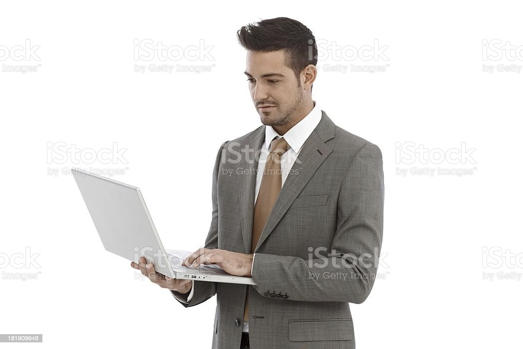 Young businessman using laptop royalty-free stock photo
