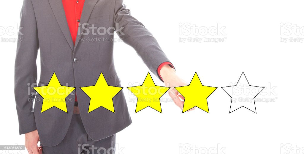 Young businessman with 4 yellow ranking stars isolated stock photo