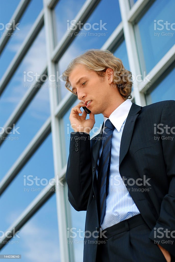 young businessman with a cell phone royalty-free stock photo