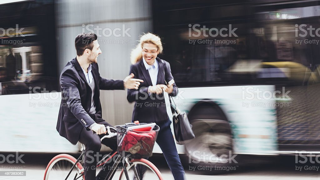 Young businessman with bike on the street stock photo