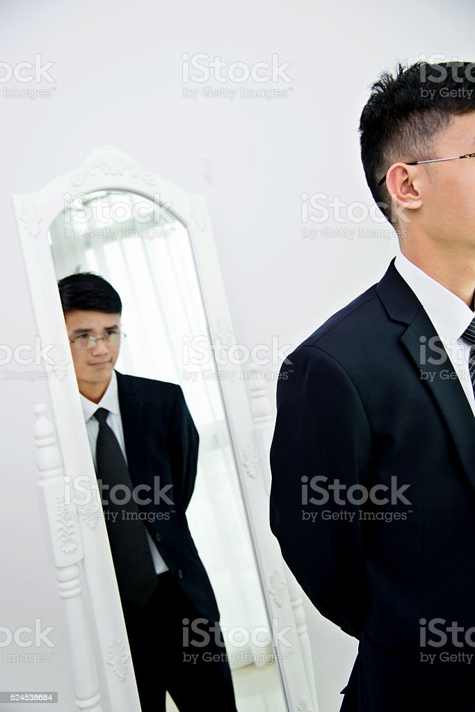 Young businessman with bizarre reflection stock photo