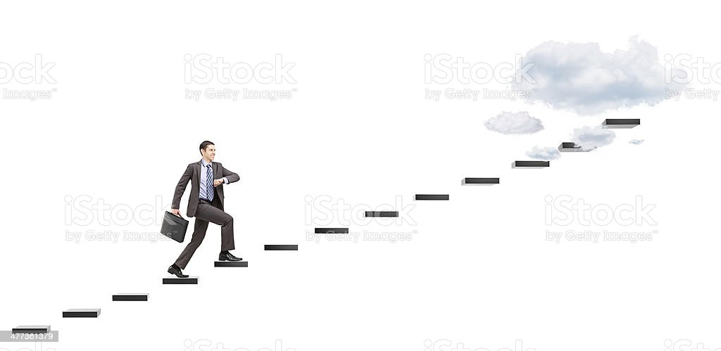 Young businessman with briefcase headings towards the heights stock photo