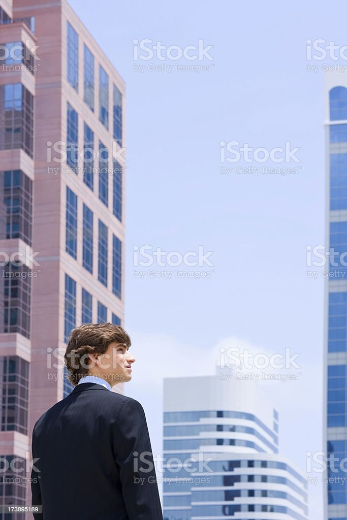 Young businessman with buildings in the background royalty-free stock photo