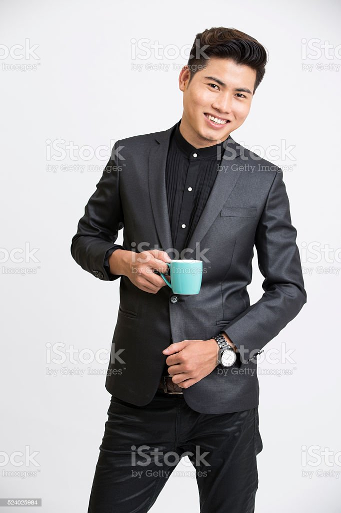 Young businessman with coffee cup stock photo