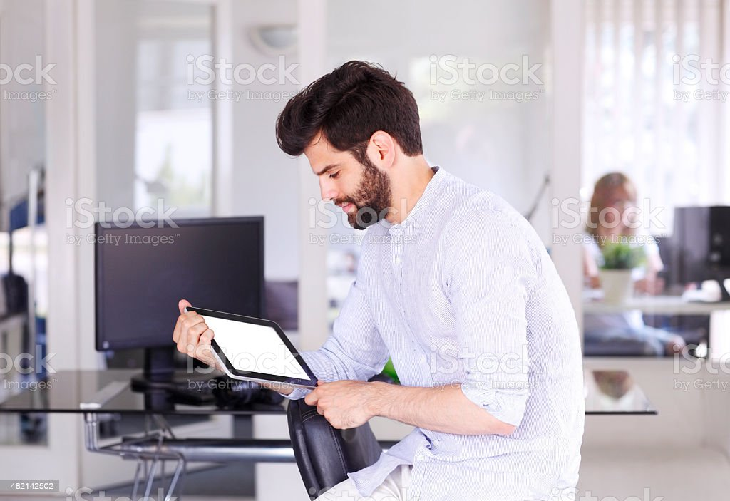 Young businessman with digital tablet stock photo