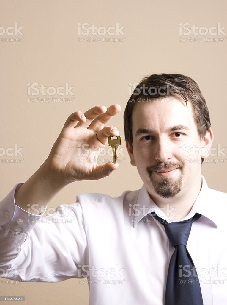 young businessman with key stock photo