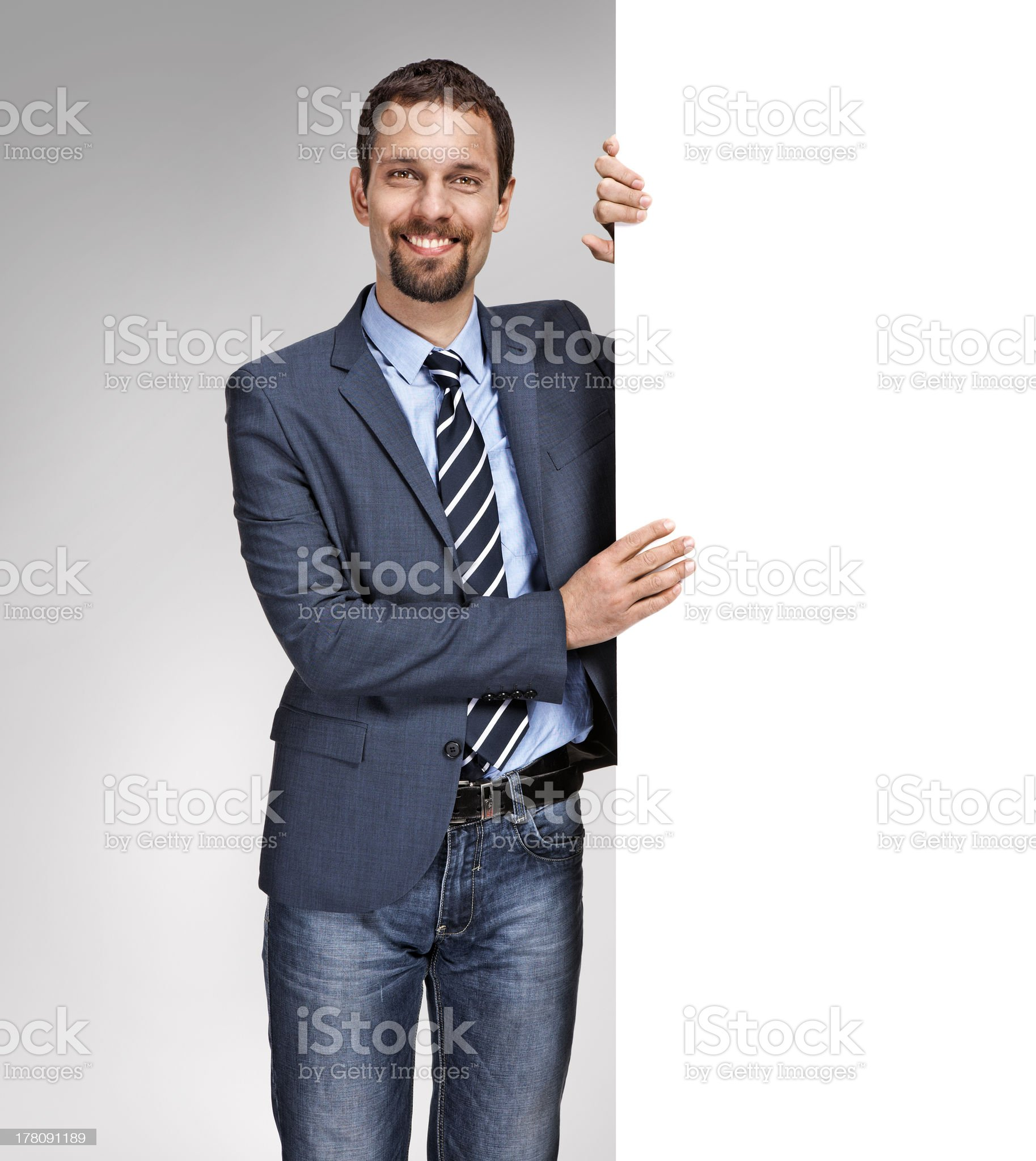 Young businessman with large white blank signboard royalty-free stock photo