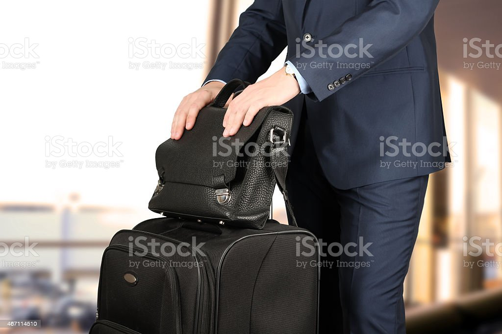 young businessman with  luggage in  the airport stock photo